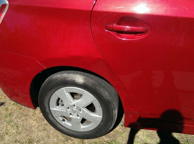 2. Prius Red Qtr Damage After