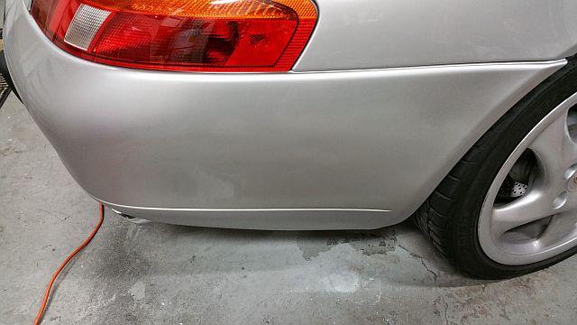 Car touch up - 1999 Porsche Carrera Silver - Rear Bumper Hole Damage - After