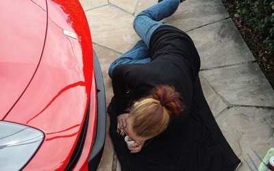 Car touch up - Serena working on F14 Ferrari bumper scrape damage
