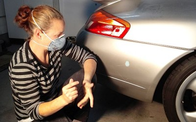 Car touch up - Serena working on Porsche Carrera bumper damage