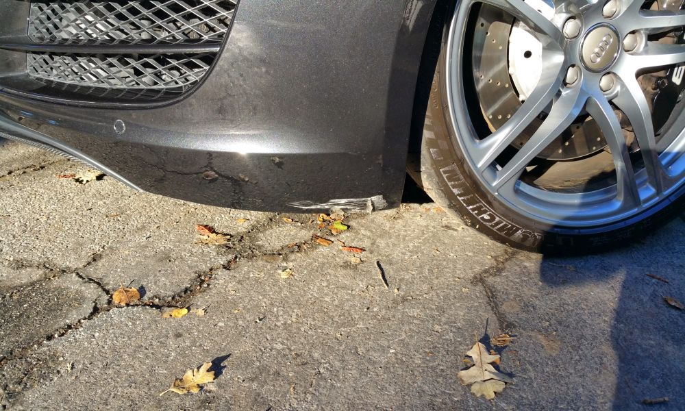 Car Touch Up - Audi R8 V10 Black - Front Bumper Scrape Damage - Before touch up